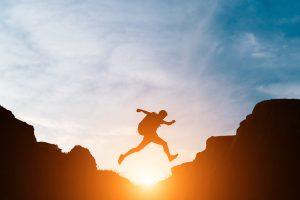 Man jump through gaps between hills